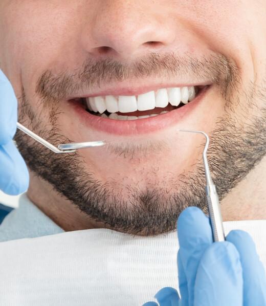 A young man getting a dental checkup.